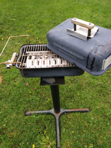 Small propane bar b q with attached stand