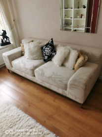 Cream patterned 2 seater Sofa
