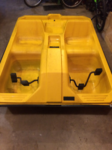 Yellow contour paddle boat