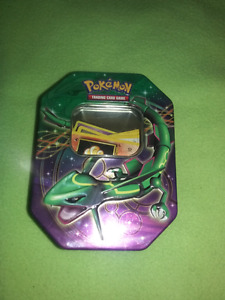For sale 100 pokemon cards tin included.