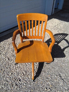Antique swivel wooden chair