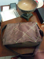 brown and green laptop bag
