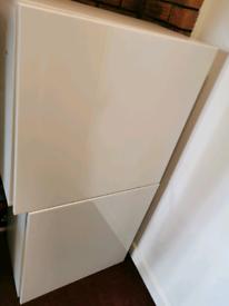 Large white storage cabinets
