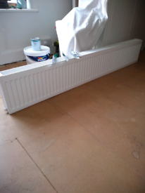 BRAND NEW COMPACT DOUBLE RADIATOR, COMPLETE WITH BRACKETS AND GRILLS.