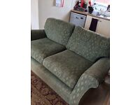 Marks and Spencer's 2 seater green patterned sofa.