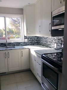 Fully Renovated West End Townhouse with yard and garage