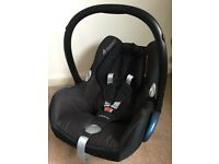 Maxi-Cosi CabrioFix 0+ car seat (black) and Maxi-Cosi rain cover - good used condition