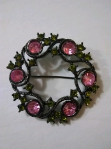 Pink and green gem brooch