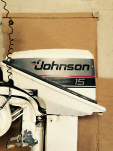 Late 80's Johnson 15hp outboard motor with tank