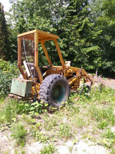 Case 580 Tractor with loading bucket