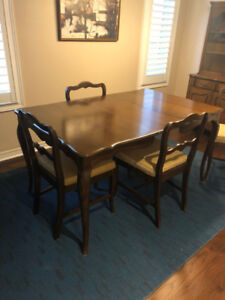 dining set with matching hutch. 4 chairs. quality wood.