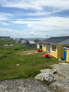 Quaint Oceanside cottage beside the rocks of Peggy's Cove