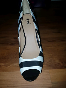 Brand new FIONI heels  never out of the box .
