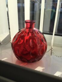 Red dimple glass ornament.
