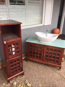 Bathroom sink and cabinet for sale.