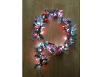 Lit Christmas garland in silver and red. 1.8m length