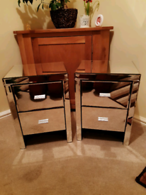Two matching mirrored bedside cabinets