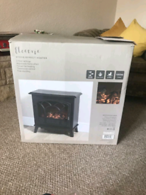 Brand new Electric log effect fire in box