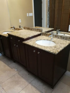 Bathroom vanity with granite and faucets