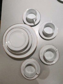 Set of dinner plates and coffee mugs