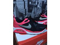 Pink and black nikes size 5