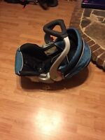 BabyTrend infant car seat and stroller with two car seat bases