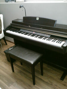 For sale, in Red Deer, Electric Yamaha Clavinova Piano
