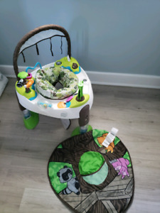 Exersaucer with mat