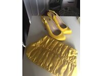 Yellow satin shoes and bag