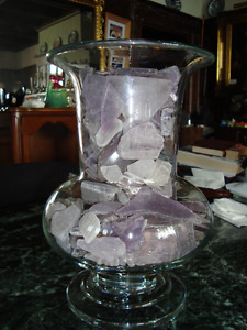 Vase filled with purple beach glass