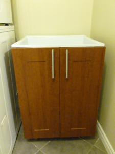 Laundry sink, faucet and wall cabinet