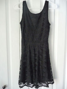 For Sale..Cute short black dress with lace over top.