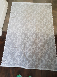 Scalloped white lace curtain panels