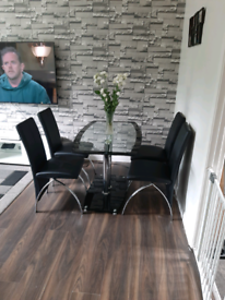 Glass 4 seater table with 4 leather chairs