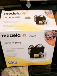 Medela pump in style breast pump, with tons of extras!!!
