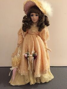 Genuine Porcelain Doll by Rebecca Mamouré. Hand painted.