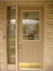 Main Front Door With Decorative Glass and Matching Side Light