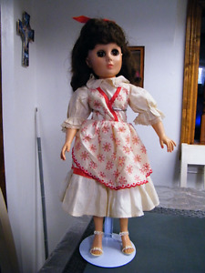 VINTAGE DEE CEE DOLL WITH ORIGINAL DRESS AND HEEL SHOES.