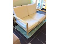 Ikea wooden frame sofa / chair. Very comfy. For indoor use but can be used for garden