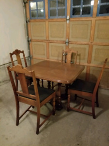 Antique card table. Comes with 5 chairs