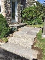 Retaining walls, stone walkways, & stone patios.