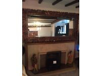 Large hand carved mirror