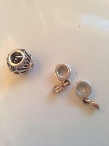 Authentic TWO TONE PANDORA charms, two retired.