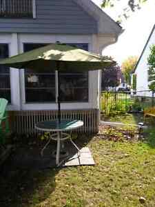 Patio table and umbrella with stand