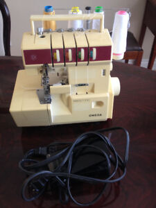 Brand Omega 4 threads Solid Serger Machine like new in box