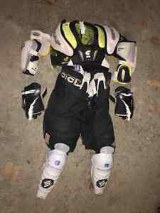 Junior ice hockey pants, vest, elbow/knee pads, gloves! West Island Greater Montréal image 1