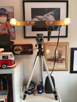 Vintage combo of tripo, movie light and camera.