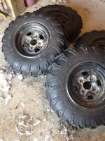 Four wheeler tires stock tires and rims never used