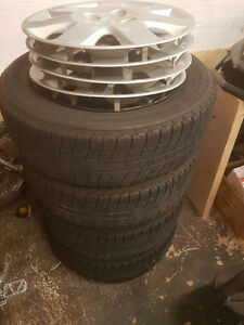 "15""Winter tires on rims  Bridgestone Blizzaks 5 bolt Honda"