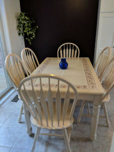 Beautiful sturdy unusual wooden dining table with six chairs